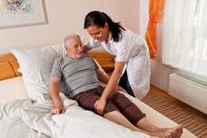 Home Care Giver Caring For An Elderly Patient